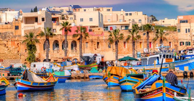 Marsaxlokk village port of Malta, illuminate by sunset light, European travel in beautiful place